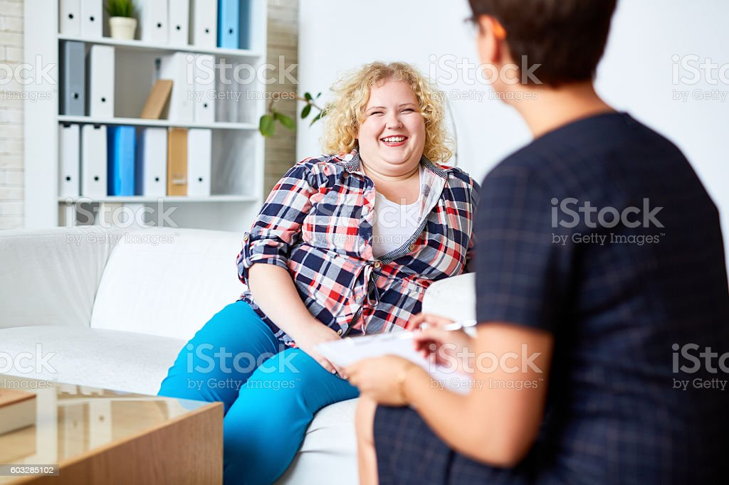 Consulting with psychologist stock photo