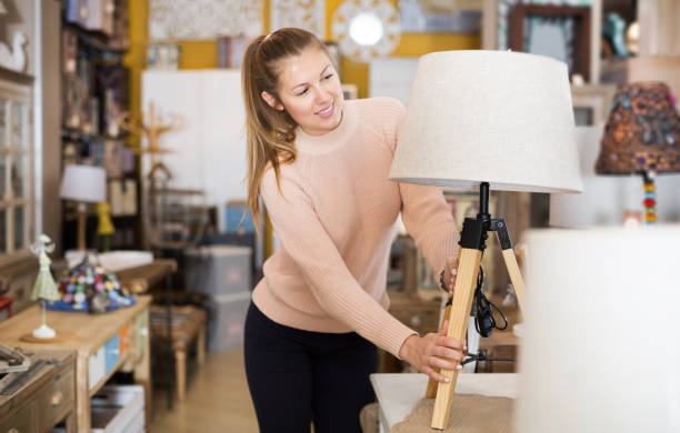 consumer choosing torchere - furniture shopping stock photos and pictures