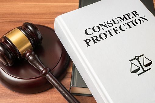 istock Consumer protection book and gavel. Law and regulations concept. 614331386
