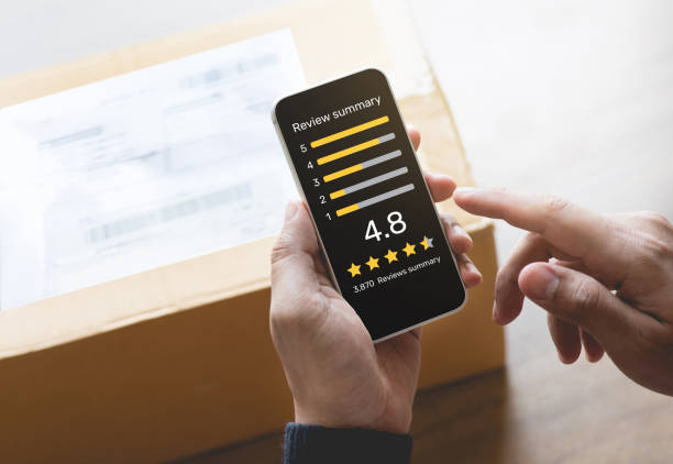 Consumer reviews concepts with young person putting report score on application smartphone and packaging product behind.rating or feedback stock photo