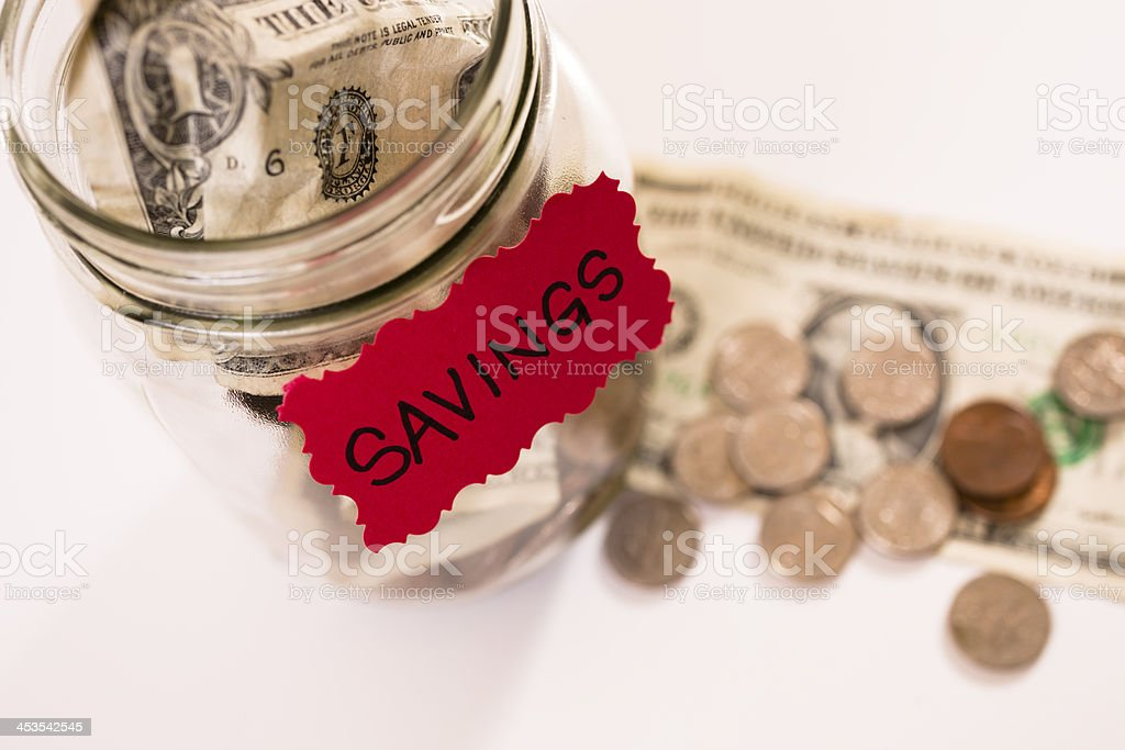 Consumerism:  Money Jar with U.S. currency.  Saving for the future. royalty-free stock photo