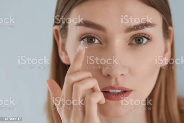 Contact eye lens woman applying eye contacts on eyes closeup picture id1157099217?b=1&k=6&m=1157099217&s=612x612&h=pv1rdtyzsqhzsno5drr0kpj0k1cm 3jj6zrzr921d6g=