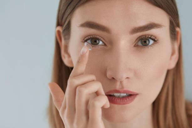 Contact eye lens woman applying eye contacts on eyes closeup picture id1157099217?b=1&k=6&m=1157099217&s=612x612&w=0&h=j2agp8re6potz3e3yj7pcpx4j3x1jvq4bnaqu35oqn4=
