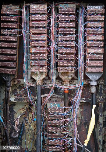 istock Contact groups and wires in the old telephone switchboard 907769300