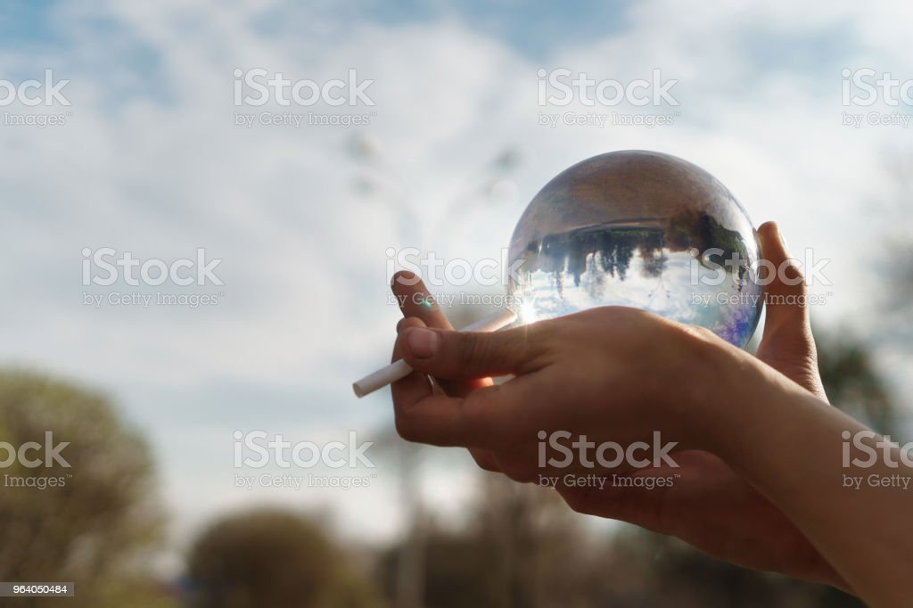 Contact juggling. Hand, acrylic ball and cigarette - Royalty-free Acrylic Glass Stock Photo