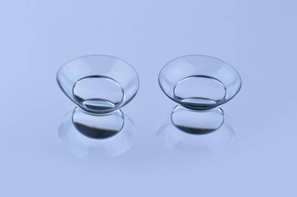 kontaktlinsen - blaue kontaktlinsen stock-fotos und bilder