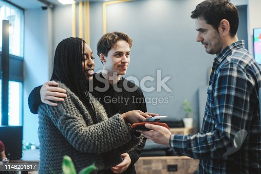 1047669026 istock photo Contact less payment with mobile phone 1148201617