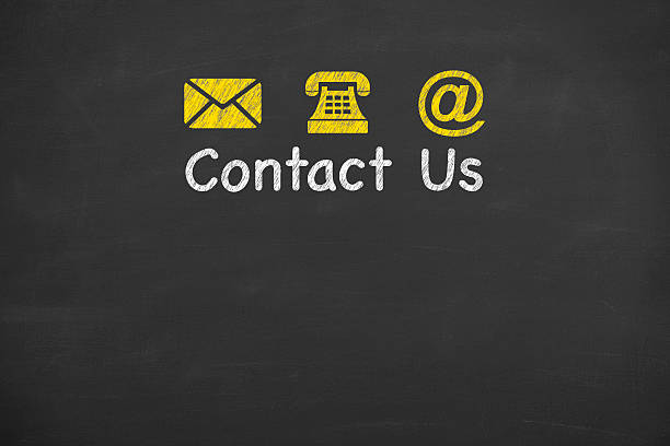 Contact Us Concept on Blackboard stock photo