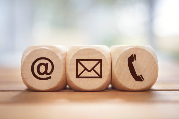 Contact us concept with wood block and symbols stock photo