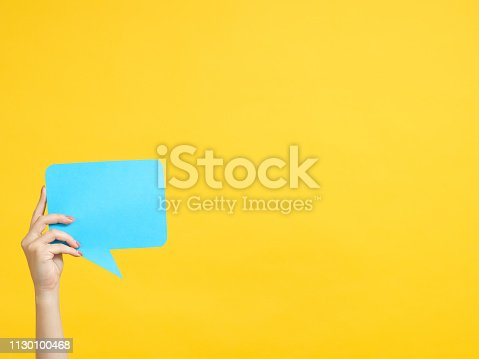 istock contact us hand speech bubble copy space 1130100468