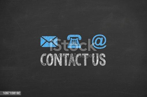 istock Contact Us on Chalkboard Background 1097158192