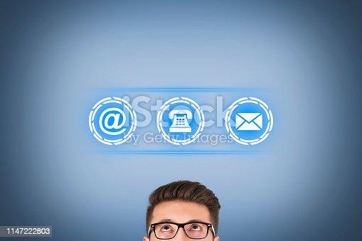 istock Contact Us over Human Head on Visual Screen 1147222803
