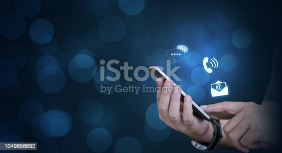 CONTACT US, businessman using mobile smartphone with the icon. Contact us connection concept with copy space.