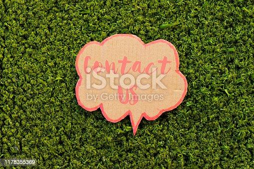 contact us speech bubble above green grass