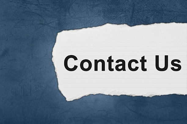 Contact us with white paper tears stock photo