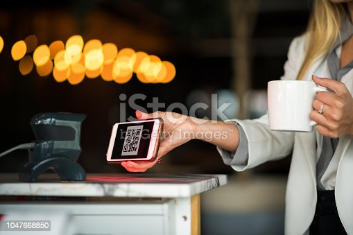 1047669026 istock photo Contactless payment by smart phone 1047668850