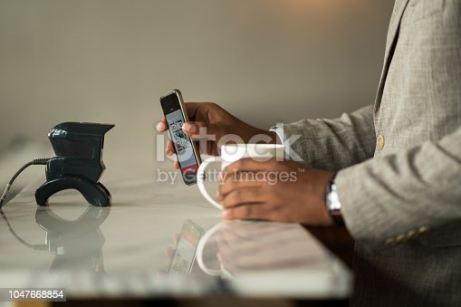 1047669026 istock photo Contactless payment by smart phone 1047668854