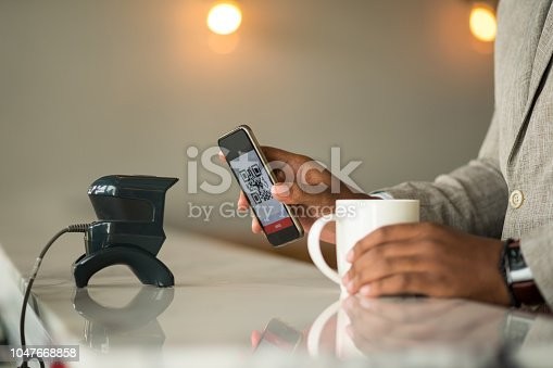 1047669026 istock photo Contactless payment by smart phone 1047668858