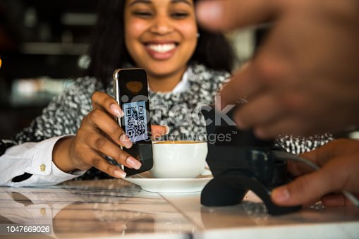 1047669026 istock photo Contactless payment by smart phone 1047669026
