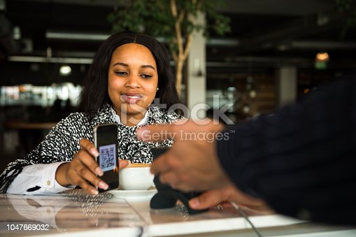 1047669026 istock photo Contactless payment by smart phone 1047669032
