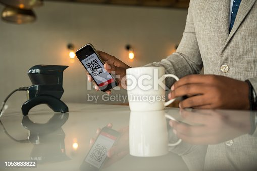 1047669026 istock photo Contactless payment by smart phone 1053633822