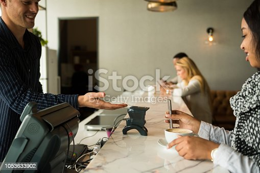 1047669026 istock photo Contactless payment by smart phone 1053633902