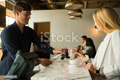 1047669026 istock photo Contactless payment by smart phone 1053633976