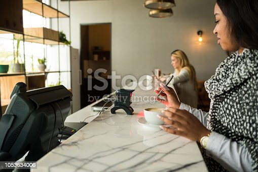 1047669026 istock photo Contactless payment by smart phone 1053634006