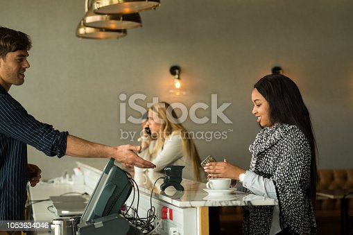1047669026 istock photo Contactless payment by smart phone 1053634046