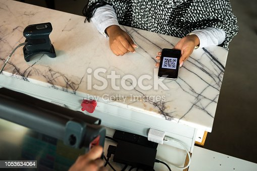 1047669026 istock photo Contactless payment by smart phone 1053634064