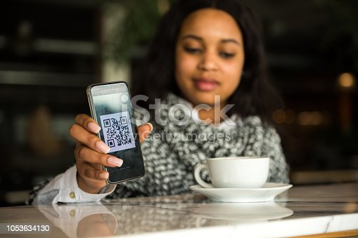 1047669026 istock photo Contactless payment by smart phone 1053634130