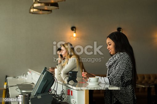 1047669026 istock photo Contactless payment by smart phone 1053634186
