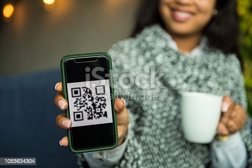 1047669026 istock photo Contactless payment by smart phone 1053634304