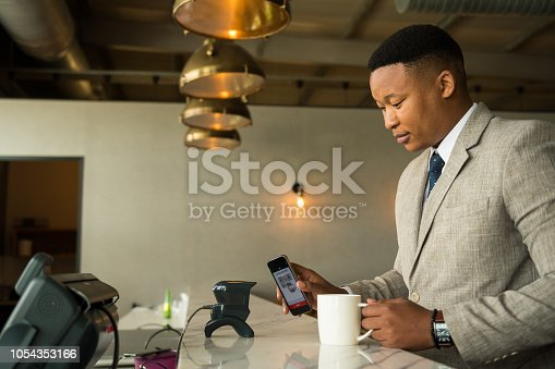 1047669026 istock photo Contactless payment by smart phone 1054353166