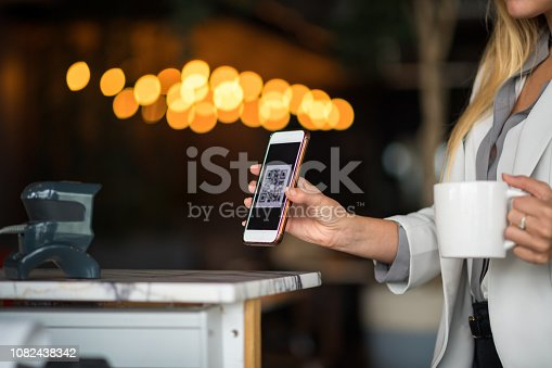 1047669026 istock photo Contactless payment by smart phone 1082438342