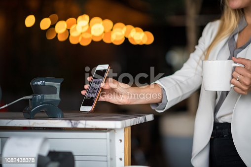 1047669026 istock photo Contactless payment by smart phone 1082438378