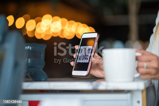 1047669026 istock photo Contactless payment by smart phone 1082438450