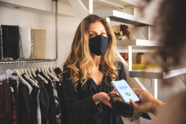Contactless payment during Covid-19 pandemic using all safety protection stock photo