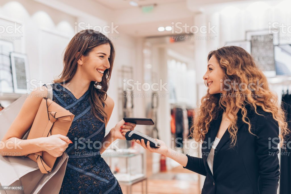 Contactless payment in a luxury fashion store stock photo