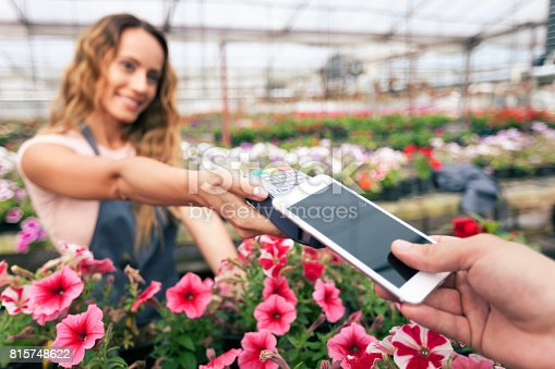 istock Contactless payment in garden center 815748622