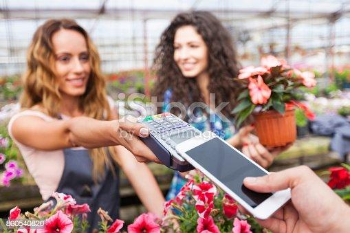 istock Contactless payment in garden center 860540820