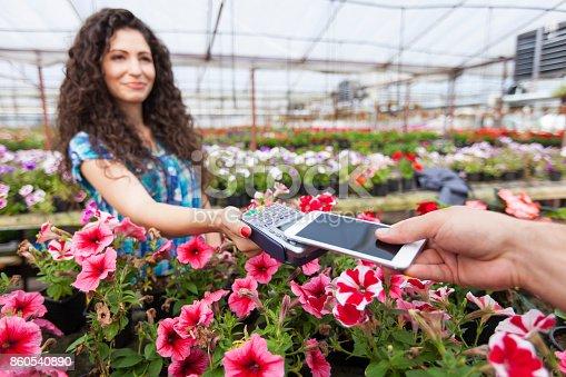 istock Contactless payment in garden center 860540890