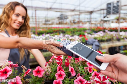 istock Contactless payment in garden center 865084482