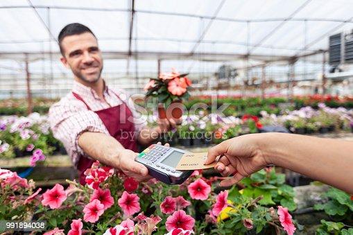 istock Contactless payment in garden center 991894038