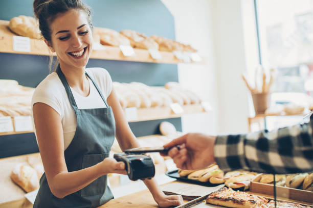 contactless payment in the bakery - contactless payment stock pictures, royalty-free photos & images