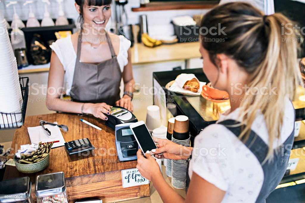 Contactless payment in the cafeteria bildbanksfoto