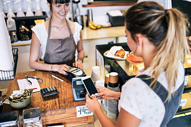 Contactless payment in the cafeteria stock photo