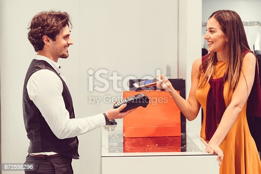 istock Contactless payment in the shop 672556296
