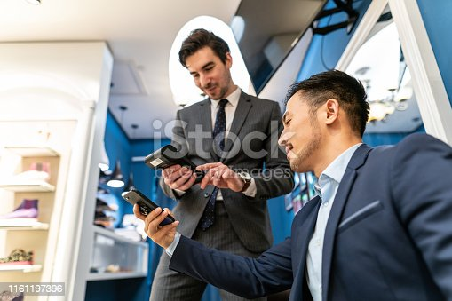 istock Contactless payment ins shoe store 1161197396