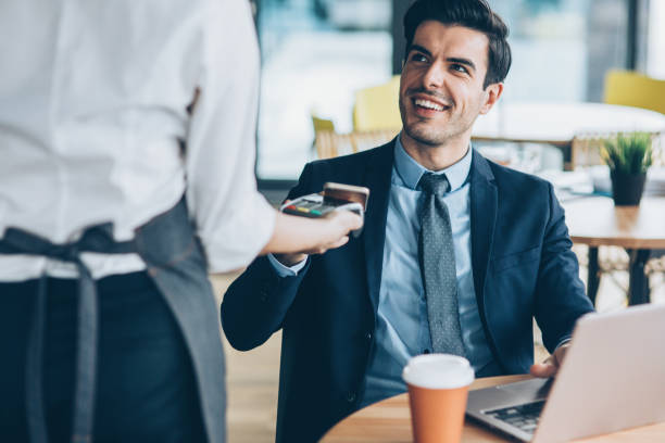contactless payment - business credit card stock photos and pictures